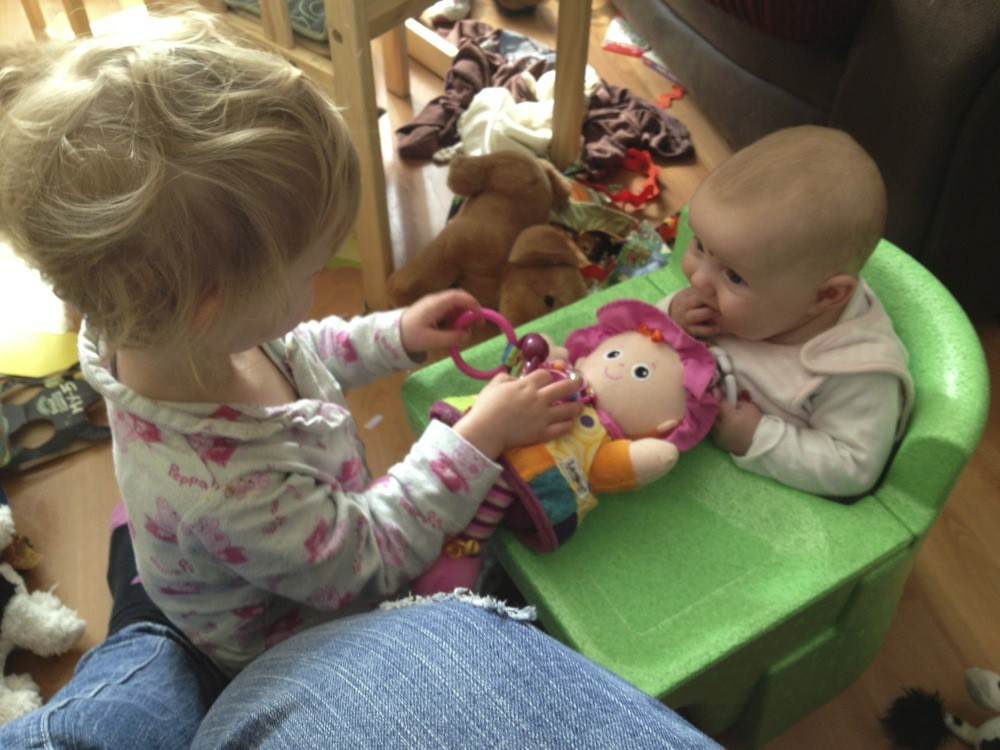 Georgie entertaining Lydia - she takes her big sister duties very seriously!