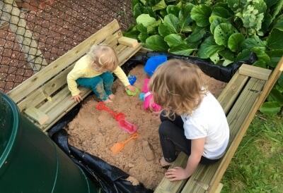 Enjoying their new sand pit!
