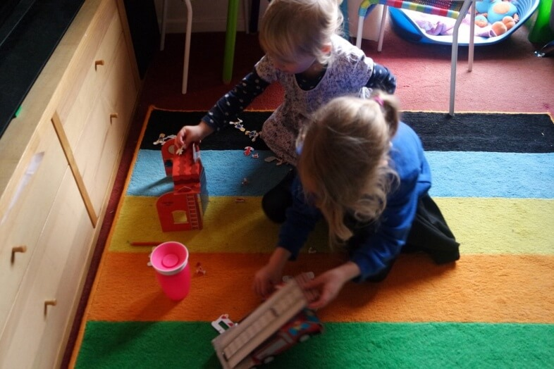 Georgie & Lydia playing with the Fire Engine