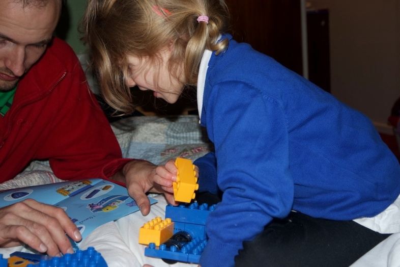 Georgie building the Peppa Pig Construction Grandpa Pig's Boat Set