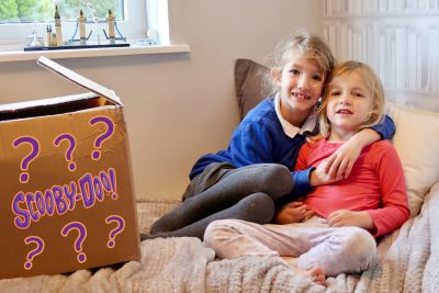Georgie and Lydia with their surprise parcel